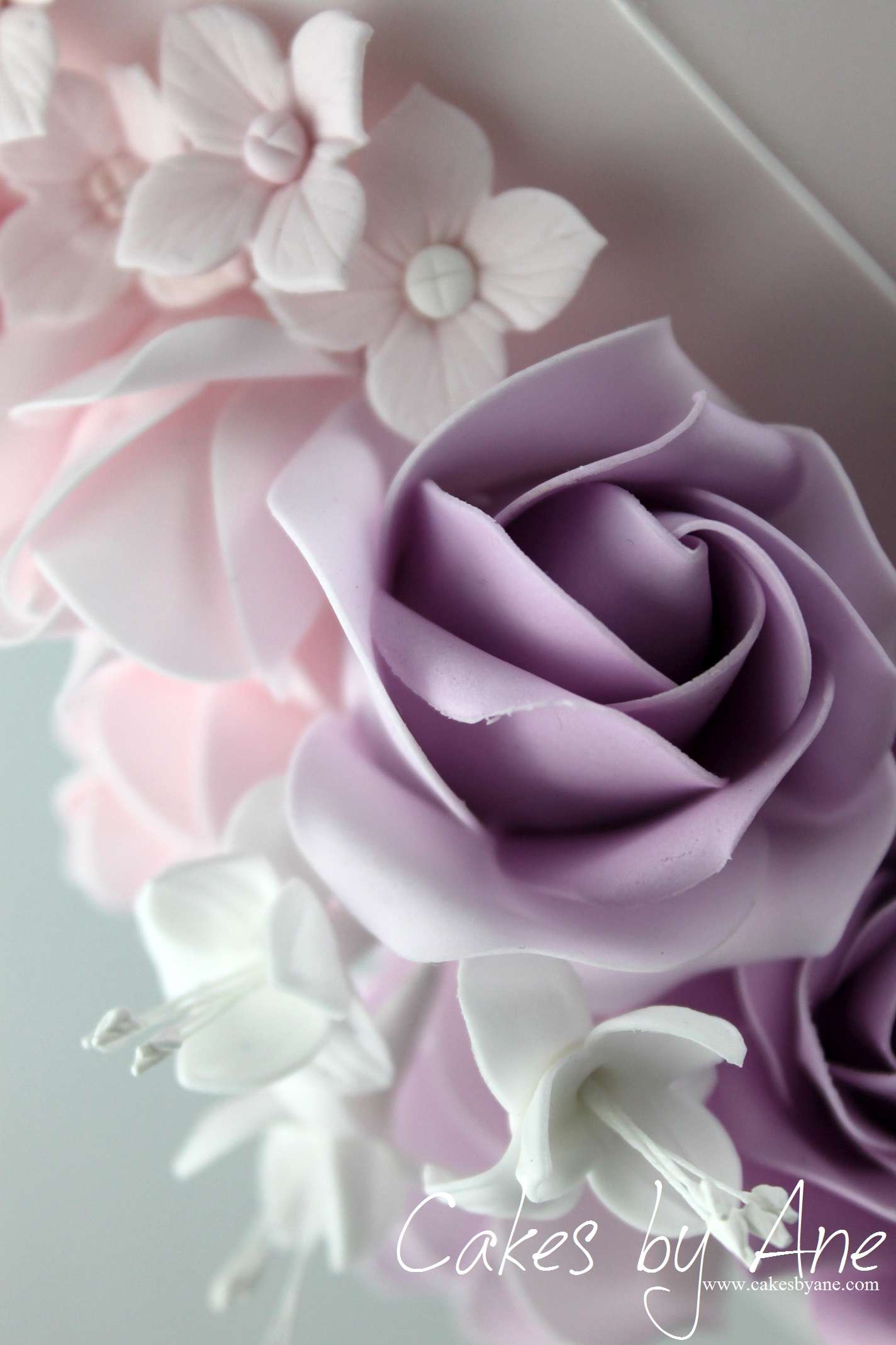 Roses Adorn This Three Tiered Wonder Enticing Your Guests To Try A Piece Of Cake Loveliness Purple Wedding